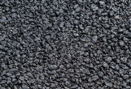 Black street asphalt with rough surface as background
