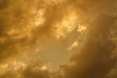 Wonderful sunset sky with golden clouds as background