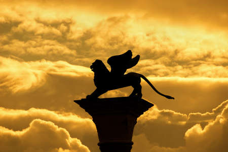 Saint Mark Winged Lion, symbol of the old Venice Republic, old medieval statue among golden clouds