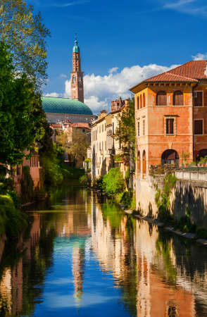 Wonderful renaissance Basilica Palladiana seen from River Retrone with reflection in Vicenza historic center Banco de Imagens