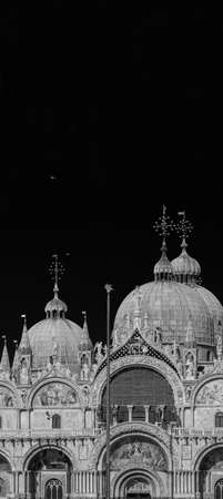 Partial view of St Mark Basilica in Venice, built in byzantine and gothic style in the Middle Ages (Black and White with copy space above) 写真素材