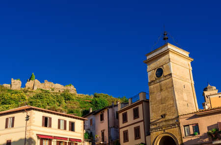 Trevigano Romano historic center with old clocktower and ancient castle ruins, a small town near Rome
