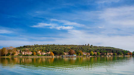 Isola Maggiore (Greater Island) of Lake Trasimeno in Umbria, with small village and the medieval St Micheal Archangel church at the top