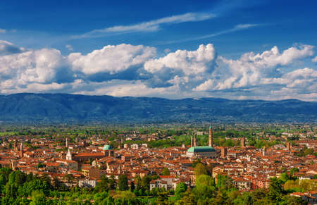 Panoramic view of Vicenza historic center with the famous renaissance Basilica Palladiana and nearby mountains, from Mount Berico terrace