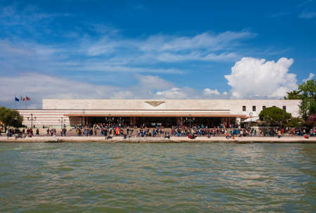 Public transport in Venice. Venezia Santa Lucia railway station with tourists seen from Grand Canal