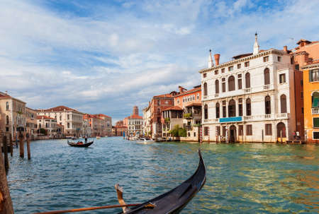 A gondola ride along the famous and beautiful Grand Canal in the center of Venice Banco de Imagens