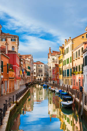 View of Rio Marin, a characteristic Venice canal with old traditional and colorful houses in the quiet Santa Croce District Banco de Imagens