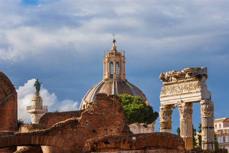 Ancient ruins, classical monuments and baroque church in the historic center of Rome