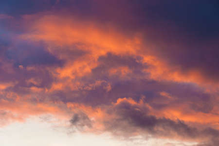 Winter sunset sky and clouds with beautiful colors as background Banco de Imagens
