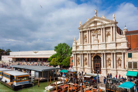 Public transport in Venice. Venezia Santa Lucia railway station with ferry boats and water taxi stops in front of the old Church of the Scalzi Banco de Imagens - 140051071