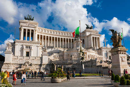 Tourists visit the famous and iconic Vittoriano monument (Altar of Nation) in the center of Rome