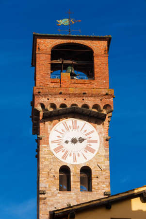 Lucca medieval Torre delle Ore (Clock Tower), a city landmark, with blue sky