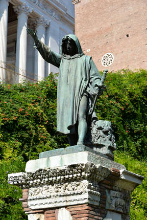 Bronze statue of Cola di Rienzo, a very powerful politician in the medieval Rome, who tried to unify Italy in the 14th century. The statue was cast in the 1887 and put on a ancient roman pedestal.