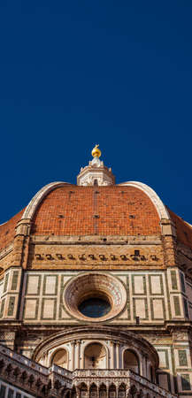 Beautiful dome of Saint Mary of the Flower in Florence seen from below, built by italian architect Brunelleschi in th 15th century and symbol of Renaissance in the world (with copy space above) Banco de Imagens