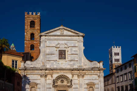 Old medieval churches in Lucca historic center with ancient bell towers Banco de Imagens