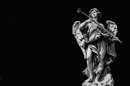 Angel marble statue with sponge, a 17th century baroque masterpiece on Holy Angel Bridge in Rome (Black and White with and copy space)