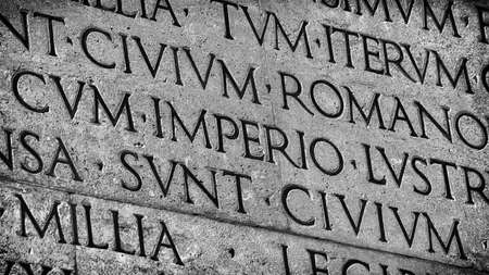 Latin ancient language and classical education. Inscription from Emperor Augustus famous Res Gestae (1st century AD), with the word Imperio in the center (Black and White) Stock fotó