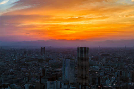 Sunset view of city endless suburbs of Meguro, Setagaya and Kawasaki wrapped in evening mist, from Ebisu