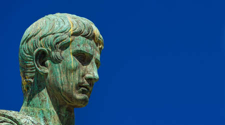 Caesar Augustus, first emperor of Ancient Rome and father of the nation. Old bronze statue along the Imperial Forum Road