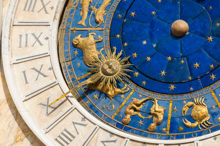 Ancient time, astrology and horoscope. Detail of Saint Mark Square old Clocktower with Spring zodiac signs, planets and stars (15th century)