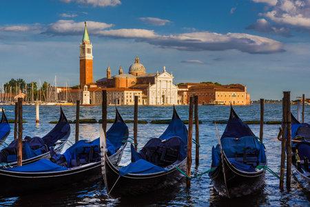 San Giorgo Maggiore (St George) Island and Church in Venice Lagoon seen through gondolas