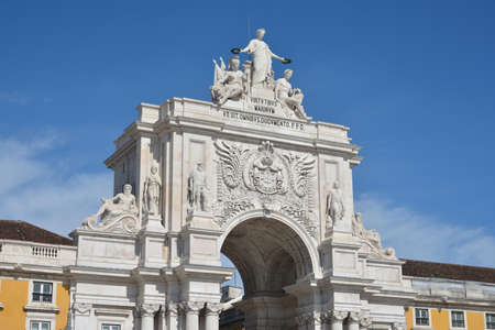 Monumental Arch in Praca do Comercio square with Portugal emblem