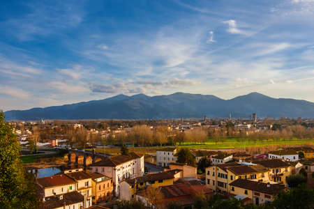 View of Lucca historic center with its famous medieval towers and River Serchio from Monte San Quirico panoramic terrace