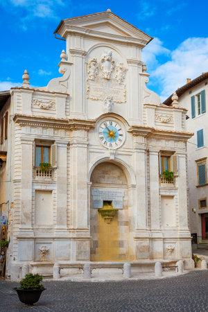 The 18th century baroque Fontana di Piazza Mercato (Market Square Fountain), with ancient clock, in the historic center of Spoleto