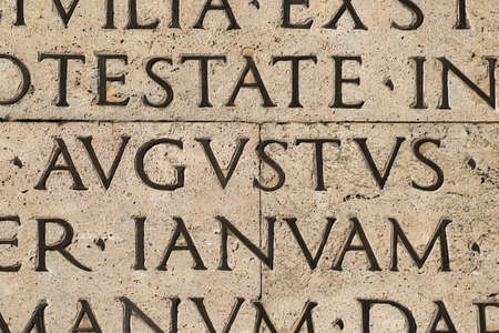 Latin ancient language. Inscription from the famous Res Gestae (1st century AD), with the word Augustus in the center