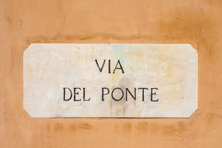 Via del Ponte (Bridge Road) old characteristic road sign in the historic center of Spoleto, the street that leads to the city panoramic terrace and the famous Ponte delle Torri (Towers Bridge) 版權商用圖片