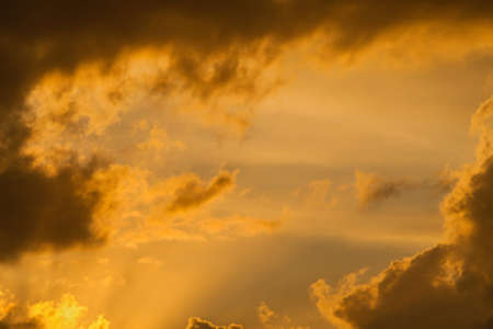 Sunset sky with golden clouds as background 版權商用圖片