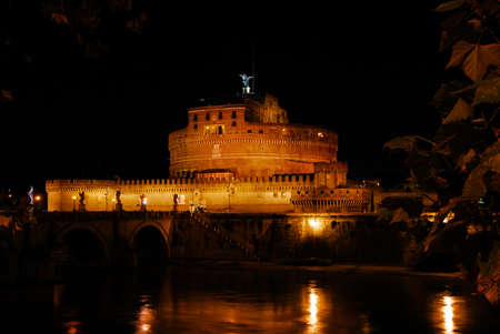 Night view of the famous national monument Castel San'Angelo (Holy Angel Castle) illuminated with River Tiber, in the historic center of Rome