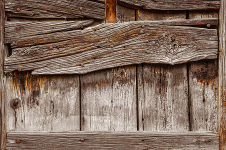 Old wooden boards with iron nails and worn varnish background Фото со стока