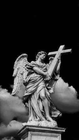 Angel holding the Holy Cross with heavenly clouds. A 17th century baroque masterpiece at the top of Sant'Angelo Bridge in the center of Rome (Black and White with copy space above)
