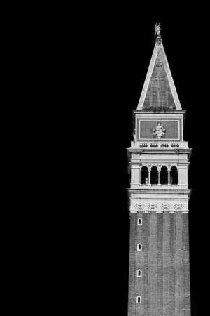 Saint Mark bell tower in the center of Venice with golden angel statue at the top (Black and White with copy space) Archivio Fotografico