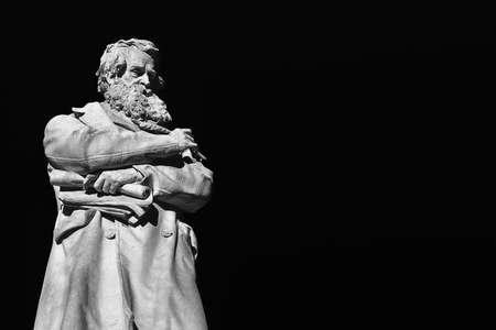 Intellectual and wise man. Marble statue of Niccolo Tommaseo erected in 1882 in the center of Venice Santo Stefano square (Black and White with copy space) Archivio Fotografico