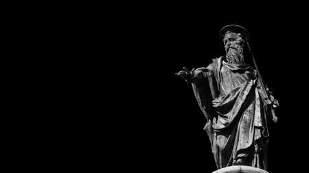 Roman Catholic Church. St Paul statue at the top of Column of Marcus Aurelius in the center of Rome (Black and White with copy space)