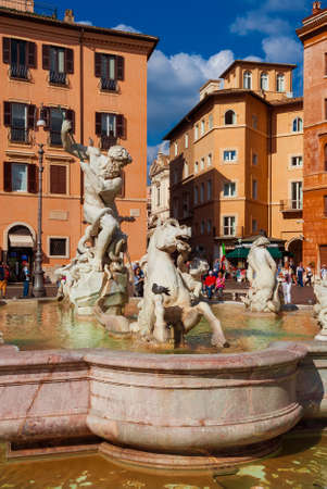 Tourists around the beautiful Fountain of the Neptune in Piazza Navona square
