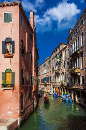 View of Rio SS Apostoli (Holy Apostles Canal)  with its colorful houses and gondola in Venice