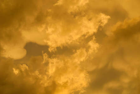 Sunset golden sky with clouds as background Archivio Fotografico