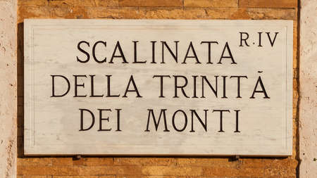 'Scalinata di Trinità dei Monti' (Spanish Steps) old traditional road sign on a brick wall, one of the most famous tourist site in Rome