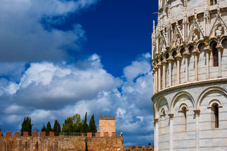 Pisa famous medieval monuments, baptistry and ancient city walls, now open to the public Archivio Fotografico