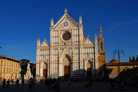 Tourism in Florence. A crowd of people in Santa Croce Square outside the famous and beautiful Basilica of the Holy Cross Редакционное