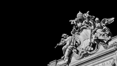 Baroque Art in Rome. Emblem of Pope Clement XII between angels with trumpets, at the top of the beautiful Trevi Fountain, 18th century (Black and White with copy space) Archivio Fotografico