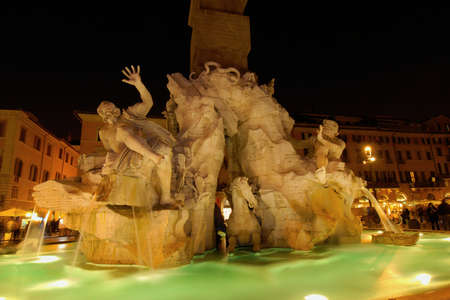 Night view of the famous Piazza Navona square in Rome with the wonderful Fountain of Four Rivers Editoriali