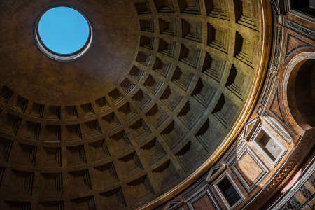 Pantheon famous coffered concrete dome in Rome, with ray of light passes through the characteristic