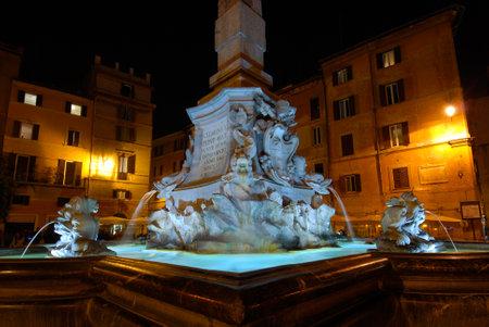 Piazza della Rotonda square with the beautiful Fountain of the Pantheon illuminated at night, in the center of Rome Editoriali