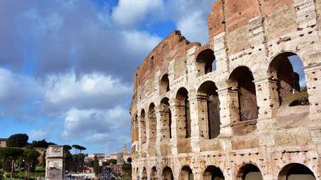Coliseum and roman archeological area with cloudy sky Archivio Fotografico