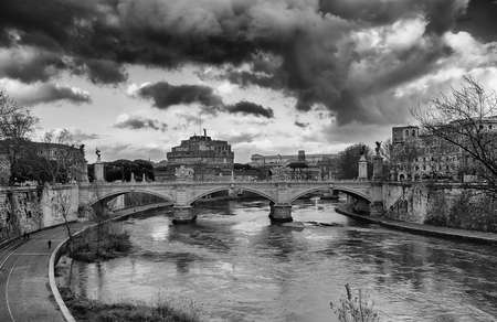 View of Rome historic center with the famous national monument Castel San'Angelo (Holy Angel Castle) and River Tiber (Black and White)