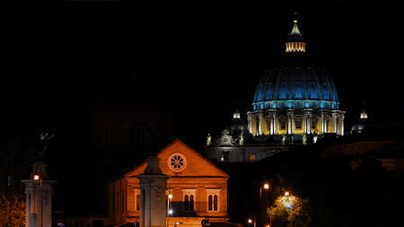 Night in Rome. View of the iconic St Peter dome illuminated, in the city historic center Editoriali